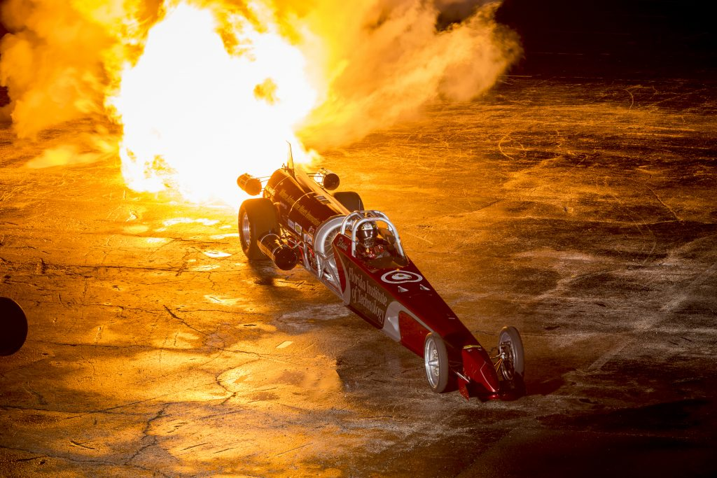 Female Jet Dragster goes full throttle in her car, Elaine Larsen