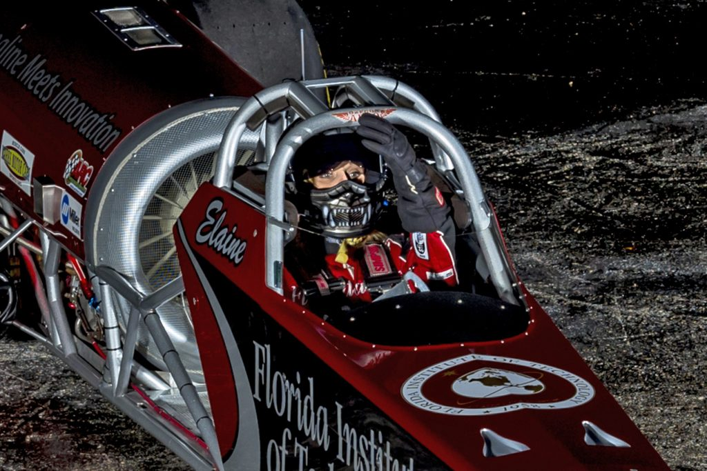 female jet dragster elaine larsen in her car